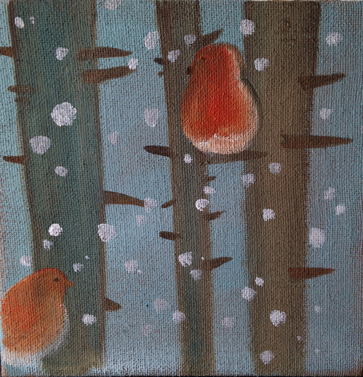 Uccellini sotto la neve